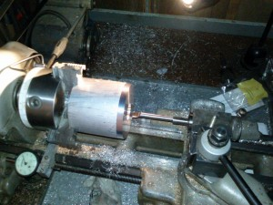 Boring the pulley for the shaft and bronze bearings.