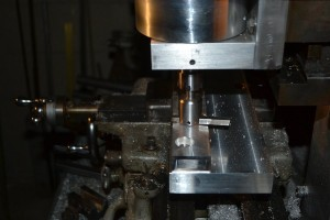 Fly cutting the spine slotting fixture base.  This ensures that the spine is held parallel to the table so that the slot in the spine is, in turn, parallel to the sides of the spine.