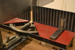 Remove the board and place two shims on the bed.  The depth of the dadoes will be equal to the thickness of the shims.