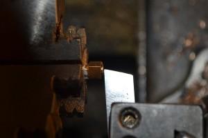 Shoulder milled on end of shank; milling the end concave.