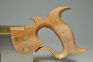 Apple, showing the contrast between the lighter sapwood and darker heartwood.