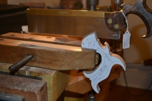Completing the slot with another saw.