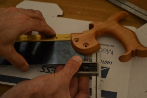 Measure the distance from the bottom of the blade to the end of the slot in the handle.