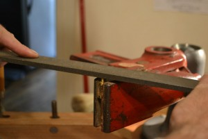 Filing the bolt to length.