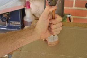Marking the bolt hole.