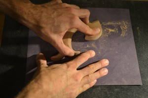 Sanding the flats. Take care that the sandpaper does not raise up and dub the edges.