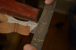Using a Vixen file to cut the chamfer.