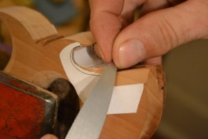 Rounding over the lamb's tongue with the handle maker's rasp.