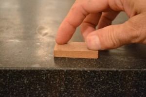 After stoning to correct the drift, the next offcut is also checked for flatness.
