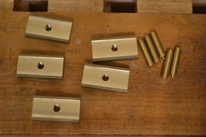 Bronze bar cut into lengths, with threaded rods.