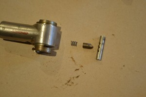 From left to right: spring, pawl, and ratchet selector (this is the proper order for reassembly).